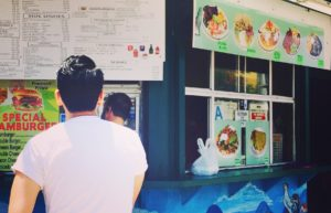 Man ordering tacos